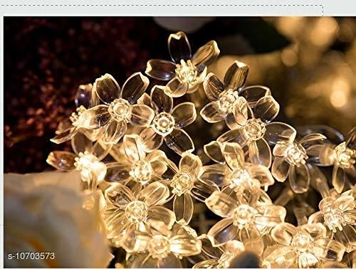 Diwali Lightings Arnah Treasure Flower Fairy String Lights, 20 LED Christmas Lights for Diwali Home Decoration (Warm White)  *Product Name* Arnah Treasure Flower Fairy String Lights, 20 LED Christmas Lights for Diwali Home Decoration (Warm White)  *Material* Plastic  *Color* Yellow  *Sizes*   *Sizes Available* Free Size *    Catalog Name:  Diwali Lightings CatalogID_1966225 C98-SC1377 Code: 563-10703573-
