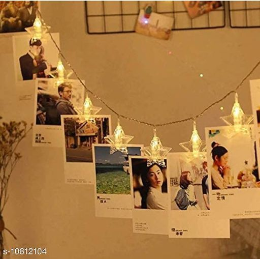 Diwali Lightings 16 Clips Fairy Twinkle Diwali Party Christmas Home Decor Festivals Lights for Decoration for Hanging Photos, Cards and Artwork - Warm White  *Product Name* 16 Clips Fairy Twinkle Diwali Party Christmas Home Decor Festivals Lights for Decoration for Hanging Photos, Cards and Artwork - Warm White  *Material* PVC  *Multipack* 1  *Color* Yellow  *Type* LED Lighting Series  *Power* 18 Watts  *Length* 3 Mtr  *Ball Diameter* 1 cm  *Waterproof* No  *Sizes*   *Sizes Available* Free Size *    Catalog Name:  Diwali Lightings CatalogID_1992072 C98-SC1377 Code: 505-10812104-