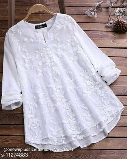 Heavy cotton and net with fully embroided top