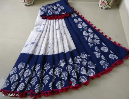 The Kanha  Pure Mulmul Cotton bagru print Saree in with exclusive pompom less border