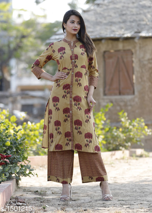 Kurta Sets Stylish Cotton Kurta Set  *Fabric* Kurti - Cotton, Palazzo - Cotton  *Sleeves* 3/4 Sleeves Are Included  *Size* Kurti - M - 38 in, L - 40 in, XL - 42 in, XXL - 44 in, XXXL - 46 in, Palazzo - M - 30 in, L - 32 in, XL - 34 in, XXL - 36 in, XXXL - 38 in  *Length* Kurti - Up To 46 in, Palazzo - Up To 38 in  *Type* Stitched  *Description* It Has 1 Piece Of Kurti With 1 Piece Of Palazzo  *Work* Kurti & Palazzo - Printed Work  *Sizes Available* S, M, L, XL, XXL   Catalog Rating: ★3.9 (173) Supplier Rating: ★4 (3717) SKU: Maroon Kurta Palazzo Set Shipping charges: Rs1 (Non-refundable) Pkt. Weight Range: 500  Catalog Name: Ariya Stylish Cotton Kurta Set Vol 2 - AA Retail Code: 566-1501215--787