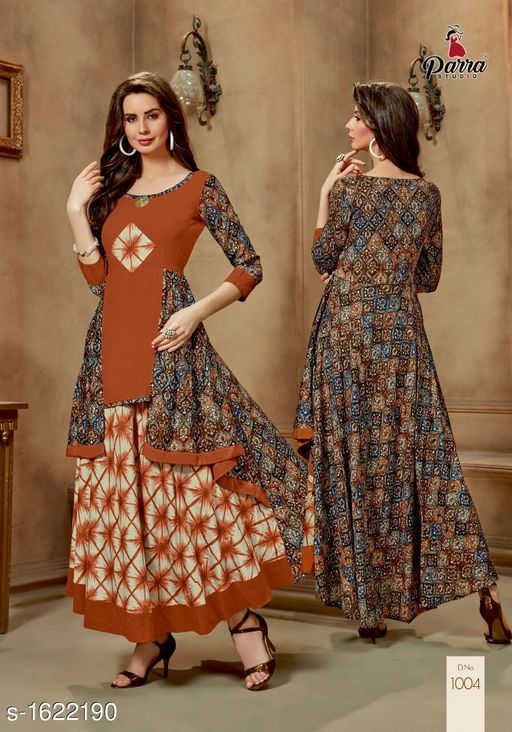 Kurtis & Kurtas Trendy Printed Women's Gown Style Kurti  *Fabric* 14 kg Rayon  *Sleeves* Sleeves Are Included  *Size* M - 38 in, XL - 42 in, 2XL - 44 in  *Length* Up To 52 in  *Type* Stitched  *Description* It Has 1 Piece of Gown Style Kurti  *Work* Printed  *Sizes Available* XL, XXL   Catalog Rating: ★4.5 (4) Supplier Rating: ★4.1 (40) SKU: PS4 Free shipping is available for this item. Pkt. Weight Range: 300  Catalog Name: Alisha Pretty Printed Gown Style Kurtis Vol 1 - SATYAM Fashion Code: 0501-1622190--