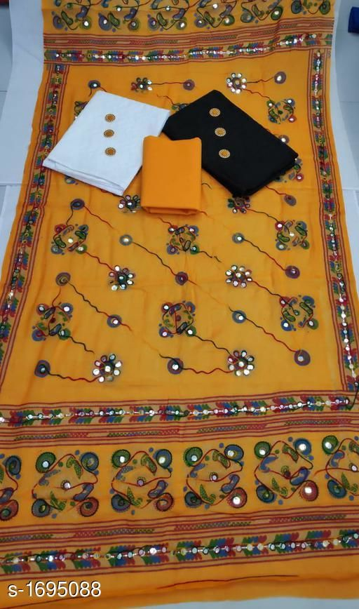 Voguish Embroidered Cotton Suits & Dress Material