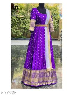 Glowing Violet Colored Partywear Woven Soft Silk Gown With Dupatta