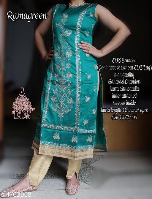 Kurtis & Kurtas Women's Embroidered Chanderi Silk Kurti  *Fabric* Kurti - Banarasi Chanderi SIlk    *Sleeves* Sleeves Are Attached Inside    *Size* M - 40 in, L - 42 in, XL - 44 in, XXL- 46 in  *Length* Kurti - Up To 46 in    *Type* Stitched    *Description* It Has 1 Piece Of Women's Kurti    *Work * Kurti - Zari work  *Sizes Available* M, L, XL, XXL *    Catalog Name: Women's Embroidered Chanderi Silk Kurtis CatalogID_231390 C74-SC1001 Code: 228-1763958-