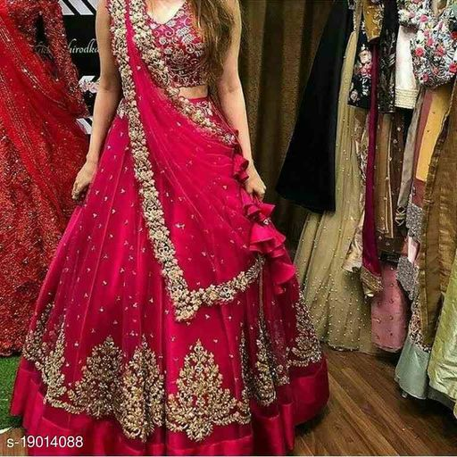 PINK COLORED PARTYWEAR DESIGNER EMBROIDERED NET WITH SILK MATERIAL LEHENGA CHOLI