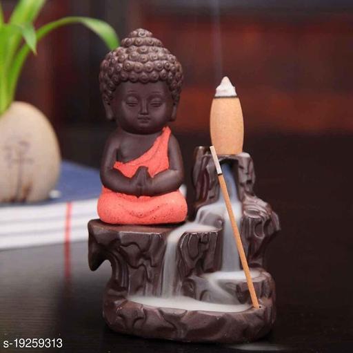 Foria Meditating Little baby Monk Buddha with 10 Smoke Backflow Cone Incense Decorative Showpiece - 12 cm (Polyresin, Orange)