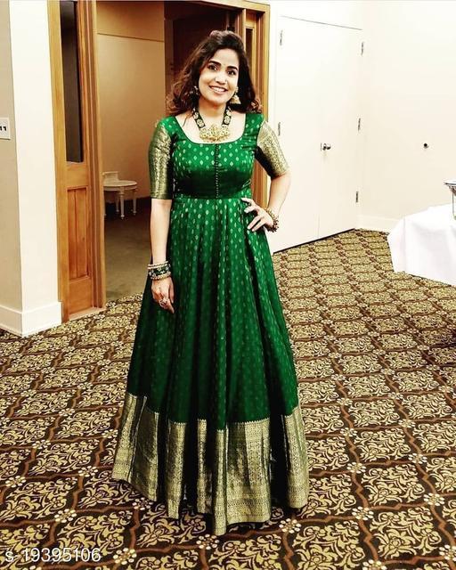 Pleasance Green Colored Festive Wear Weaving Jacquard Silk Gown