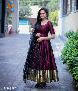 Exclusive nack pattern Purple colored  Tapeta Silk with Jacquard fabric  Ready made Gown With soft net pearl work Dupatta