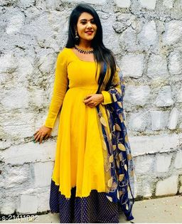 Stunning Yellow-colored With Jacquard Brokaid  Flared Maxi Gown With Beautiful Embroidery Duppata