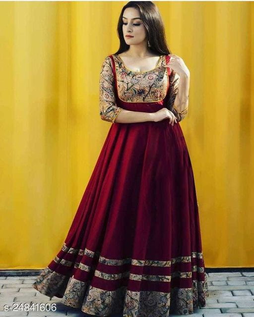 IMPOSING PEACH COLORED PRINTED GEORGETTE GOWN