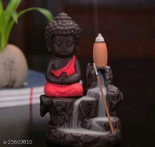 Foria Meditating Little baby Monk Buddha with 10 Smoke Backflow Cone Incense Decorative Showpiece - 12 cm (Polyresin, Red)