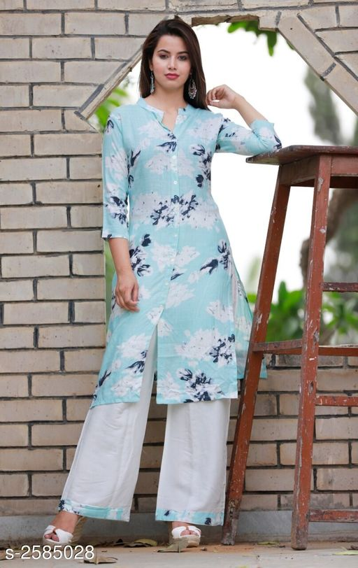 Kurta Sets Women Botanical Printed Kurti  *Fabric* Kurti - Rayon Slub, Palazzo - Rayon Slub   *Sleeves* 3/4 Sleeves Are Included   *Size* Kurti - S - 36 in, M - 38 in, L - 40 in, XL - 42 in, XXL - 44 in Palazzo - S - 28 In, M - 30 in, L - 32 in, XL - 34 in, XXL - 36 in   *Length* Kurti - Up To 46 in, Palazzo - Up To 38 in   *Type* Stitched   *Description* It Has 1 Piece Of Kurti With 1 Piece Of Palazzo   *Work* Kurti & Palazzo - Printed  *Sizes Available* S, M, L, XL, XXL   Catalog Rating: ★4 (97) Supplier Rating: ★4 (3717) SKU: Sky Blue Badal Printed Kurta Palazzo Set Shipping charges: Rs1 (Non-refundable) Pkt. Weight Range: 500  Catalog Name: Women's Printed Rayon Slub Kurta Set with Palazzos - AA Retail Code: 186-2585028--308