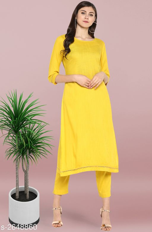 Kurta Sets Women's Solid Rayon Kurta set with Pants Fabric: Kurti - Rayon Pant - Rayon Sleeves: Sleeves Are Included Size: Kurti - XS - 34 in S - 36 in M - 38 in L - 40 in XL - 42 in XXL - 44 in 3XL - 46 in  Pant - Up To 28 in To Up To 36 in Length: Kurti - Up To 47 in Pant - Up To 36 in Type: Stitched Description: It Has 1 Piece Of Kurti With Pant Work: Kurti - Gotta Lace Work Pant - Gotta Lace Work Color: Kurti - Rayon Pant - Yellow Country of Origin: India Sizes Available: XS, S, M, L, XL, XXL, XXXL   Catalog Rating: ★4.2 (53)  Catalog Name: Janasya Trendy Women'S Straight Kurta Set Vol 2 CatalogID_358059 C74-SC1003 Code: 818-2648860-9492