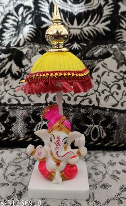 Car dashboard idols Ganesh ji