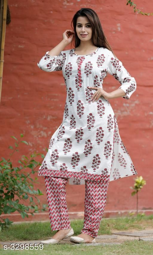 Kurta Sets Hariprima Elan Kurti Set  *Fabric* Kurti  - Cotton , Pant -   Cotton  *Sleeves* Sleeves Are Included  *Size* Kurti -  M - 38 in, L - 40 in, XL - 42 in, Pant - M - 30 in, L - 32 in, XL - 34 in,  *Length* Kurti - Up To 42 in, Pant - Up To 39 in  *Type* Stitched  *Description* It Has 1 Piece Of Kurti & It Has 1 Piece Of Pant  *Work* Kurti - Printed , Pant - Printed  *Sizes Available* M, L, XL, XXL   Supplier Rating: ★3.6 (12) SKU: SKT1112 Free shipping is available for this item. Pkt. Weight Range: 500  Catalog Name: Hariprima Elan Kurti Sets Vol 1 - SK Kripa Code: 967-3298559--