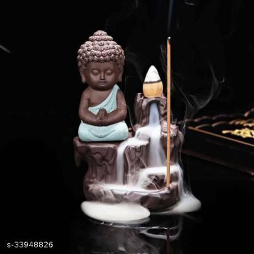 Handcrafted Meditating Little baby Monk Buddha Smoke Backflow Cone Incense Holder With 10 Sticks Decorative Showpiece  -  12 cm (Polyresin, Multicolor)
