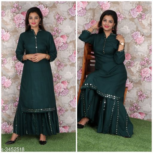 Kurta Sets Attractive Rayon Women's Kurta Set  *Fabric* Kurti - Rayon, Sharara - Rayon  *Sleeves* Sleeves Are Included  *Size* Kurti - 42 in, 44 in, Sharara - 34 in, 36 in  *Length* Kurti - Up To 46 in, Palazzo - Up To 40in  *Type* Stitched  *Description* It Has 1 Piece Of Women's Kurti & 1 Piece Of Sharara  *Work * Kurti - Mirror Work, Sharara - Mirror Work  *Sizes Available* 42, 44   Catalog Rating: ★4.4 (17) Supplier Rating: ★4 (129) SKU: ARWKS-01 Shipping charges: Rs1 (Non-refundable) Pkt. Weight Range: 500  Catalog Name: Anshu Attractive Rayon Women's Kurta Sets Vol 17 - Sabse acche suits Code: 2411-3452518--0531