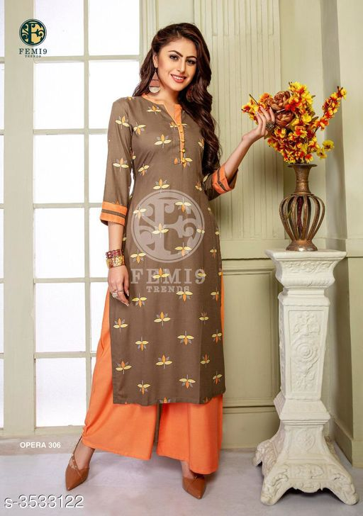 Kurta Sets New Fabulous 14 KG Rayon Women's Kurta Set  *Fabric* Kurti -  14 KG Rayon, Palazzo - 14 KG Rayon  *Sleeves* Sleeves Are Included    *Size* M - 19 in, L - 20 in, XL - 21 in, XXL - 22 , XXXL-24 ,Palazzo -  M - 19 in, L - 20 in, XL - 21 in, XXL -22, XXXL-24  *Length* Kurti - Up To 46 in, Palazzo - Up To 38 in  *Type* Stitched    *Description* It Has 1 Piece Of Women's Kurti & 1 Piece Of Palazzo  *Work* Kurti - Printed,  Palazzo -  Printed  *Sizes Available* M, L, XL, XXL, XXXL   Supplier Rating: ★4 (438) SKU: femi9-trends-opera-vol-3-rayon-exclusive-kurti-with-plazzo-collection-4 Free shipping is available for this item. Pkt. Weight Range: 350  Catalog Name: New Fabulous 14 KG Rayon Women's Kurta Sets Vol 10 - Drape Fab Code: 0211-3533122--