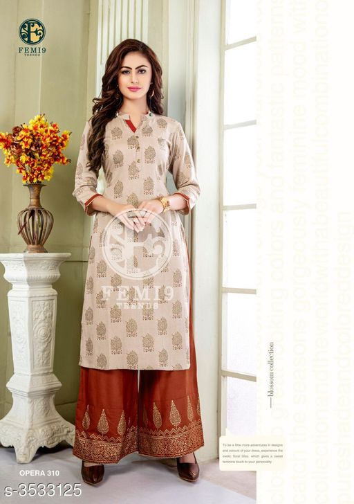 Kurta Sets New Fabulous 14 KG Rayon Women's Kurta Set  *Fabric* Kurti -  14 KG Rayon, Palazzo - 14 KG Rayon  *Sleeves* Sleeves Are Included    *Size* M - 19 in, L - 20 in, XL - 21 in, XXL - 22 , XXXL-24 ,Palazzo -  M - 19 in, L - 20 in, XL - 21 in, XXL -22, XXXL-24  *Length* Kurti - Up To 46 in, Palazzo - Up To 38 in  *Type* Stitched    *Description* It Has 1 Piece Of Women's Kurti & 1 Piece Of Palazzo  *Work* Kurti - Printed,  Palazzo -  Printed  *Sizes Available* XL, XXL, XXXL   Supplier Rating: ★4 (438) SKU: femi9-trends-opera-vol-3-rayon-exclusive-kurti-with-plazzo-collection-11 Free shipping is available for this item. Pkt. Weight Range: 350  Catalog Name: New Fabulous 14 KG Rayon Women's Kurta Sets Vol 10 - Drape Fab Code: 0211-3533125--