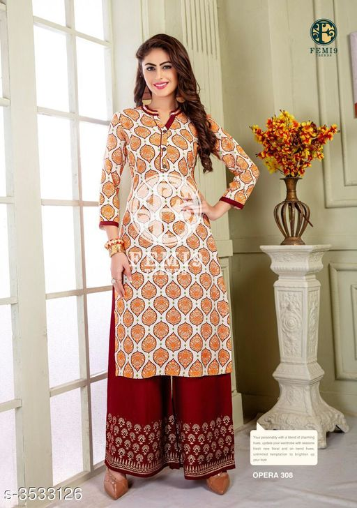 Kurta Sets New Fabulous 14 KG Rayon Women's Kurta Set  *Fabric* Kurti -  14 KG Rayon, Palazzo - 14 KG Rayon  *Sleeves* Sleeves Are Included    *Size* M - 19 in, L - 20 in, XL - 21 in, XXL - 22 , XXXL-24 ,Palazzo -  M - 19 in, L - 20 in, XL - 21 in, XXL -22, XXXL-24  *Length* Kurti - Up To 46 in, Palazzo - Up To 38 in  *Type* Stitched    *Description* It Has 1 Piece Of Women's Kurti & 1 Piece Of Palazzo  *Work* Kurti - Printed,  Palazzo -  Printed  *Sizes Available* M, L, XL, XXL   Supplier Rating: ★4 (438) SKU: femi9-trends-opera-vol-3-rayon-exclusive-kurti-with-plazzo-collection-12 Free shipping is available for this item. Pkt. Weight Range: 350  Catalog Name: New Fabulous 14 KG Rayon Women's Kurta Sets Vol 10 - Drape Fab Code: 0211-3533126--