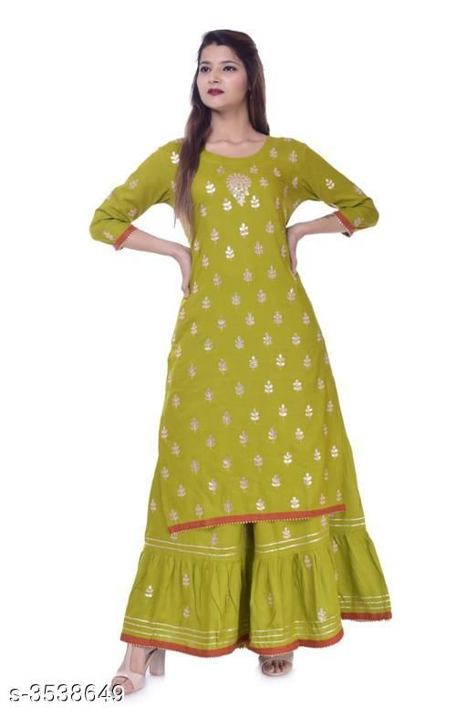 Kurta Sets Women Embroidered Rayon Kurta Set with Sharara  *Fabric* Kurti - Rayon, Sharara - Rayon   *Size* Kurti - 38 in, 40 in, 42 in, 44 in, Sharara - 30 in, 32 in, 34 in , 36 in   *Length* Kurti  - Up To 40 in , Sharara - Up To 38 in   *Type* Stitched   *Description* It Has 1 Piece Of Kurti & 1 Piece Of Sharara   *Color* Green   *Work* Kurti - Gota Work, Sharara - Gota Work  *Sizes Available* 42   Catalog Rating: ★4.4 (344) Supplier Rating: ★4.1 (3071) SKU: KEW_5th_Cat_2 Shipping charges: Rs1 (Non-refundable) Pkt. Weight Range: 500  Catalog Name: Women's Embroidered Rayon Kurta Set with Sharara - KEW Wear Code: 356-3538649--467