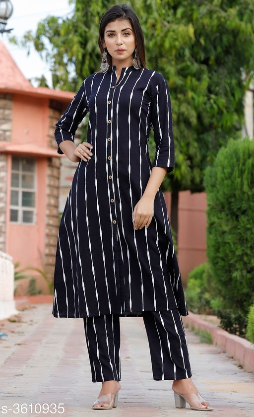 Kurta Sets Pretty Attractive Women's Kurta Set  *Fabric Kurti* Cotton, Palazzo - Cotton   *Sleeves* Sleeves Are Included   *Size* Kurti - M - 38 in, L - 40 in, XL - 42 in, XXL - 44 in, 3XL - 46 in, Palazzo   *Length* Kurti - Up To 46 in, Palazzo   *Type* Stitched   *Description* It Has 1 Piece Of Women's Kurti & 1 Piece Of Women's Palazzo   *Pattern* Striped, Palazzo - Striped  *Sizes Available* M, L, XL, XXL, XXXL   SKU: Blue Line Kurta Palazzo Set Free shipping is available for this item. Pkt. Weight Range: 500  Catalog Name: Alisha Pretty Attractive Women's Kurta Sets Vol 15 - Laxmi Industries Code: 918-3610935--