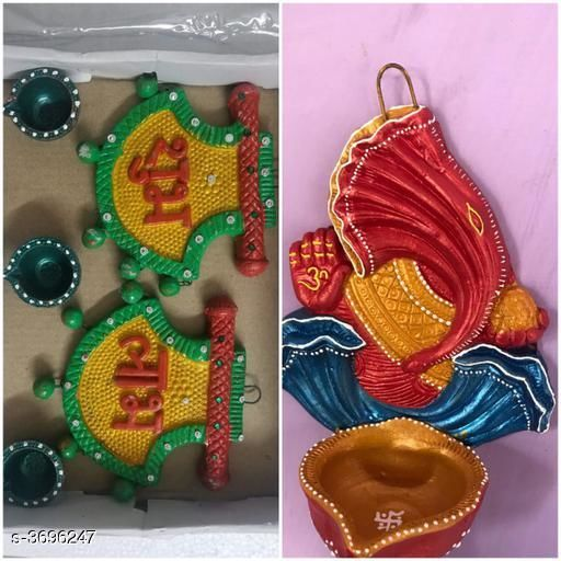 Festive Diyas & Candles Home Trendy Festive Diwali Diyas  *Material* Terracotta  *Size* ( L X B X H) Hanging Ganesh Diya  4 in x 4 in x 6 in (L X H) Shubh Labh - 4 in x 5 in, ( D X H ) Diyas - 1.5 in x 1.5 in  *Description* It Has 1 Piece Of Hanging Ganesh Diya & 1 Set Of Shubh Labh With 3 Diyas  *Sizes Available* Free Size *    Catalog Name: Dream Home Trendy Festive Diwali Diyas Vol 5 CatalogID_515646 C128-SC1604 Code: 293-3696247-