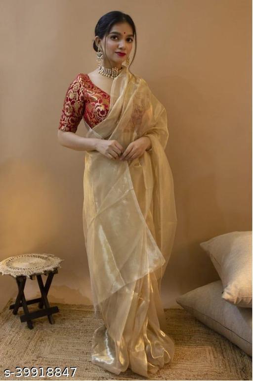 Beautifull golden colur orgenza saree and red colur woven pure zari blouse.