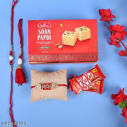 Floweraura Set Of 2 Bhaiya Bhabhi Rakhi & One Ethnic Rakhi N 250gms Soan Papdi & Chocolates With Roli Chawal And Rakhi Card For RakshaBandhan