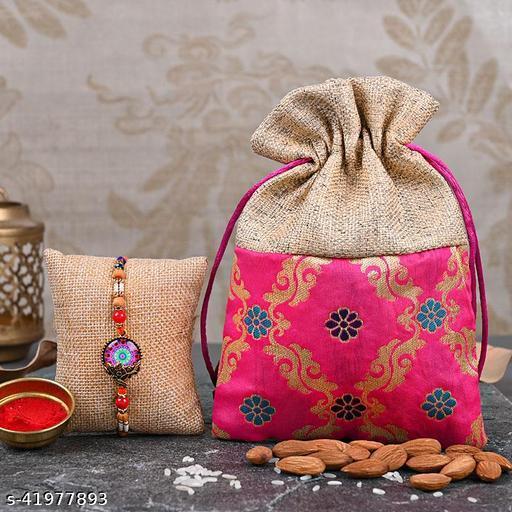 Floweraura Designer Wondrous Rakhi N 100gms Almonds In Pink Potli With Roli Chawal And Rakhi Card For Brothers
