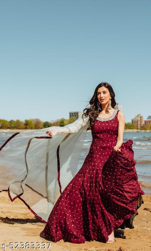 Maroon colord tapeta silk party wear women gown