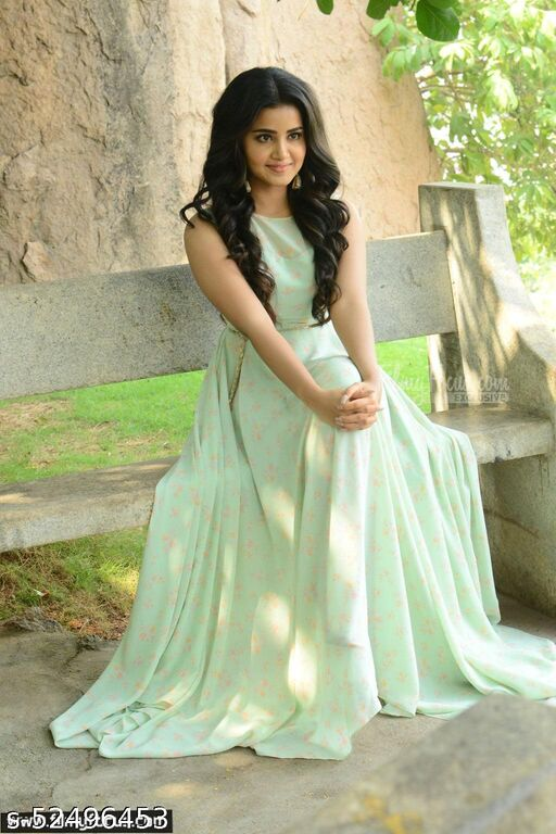 Stylish light green colored partywear cut work Georgette gown