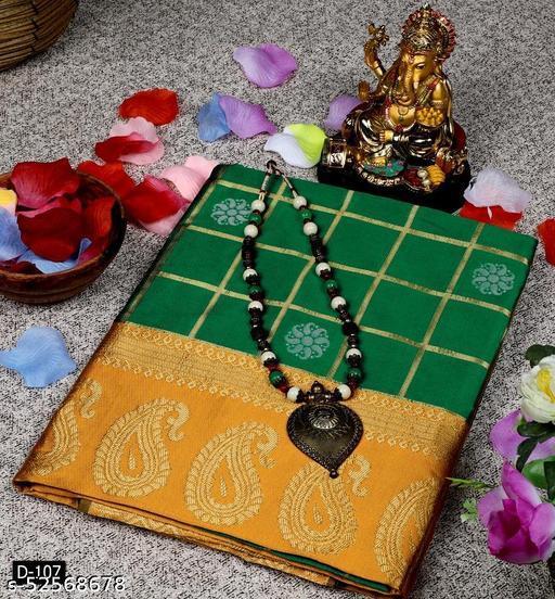 Ethnic studios presents Gadwal silk checks and butta green saree. It has a gold zari checks and silver zari butta laden body.