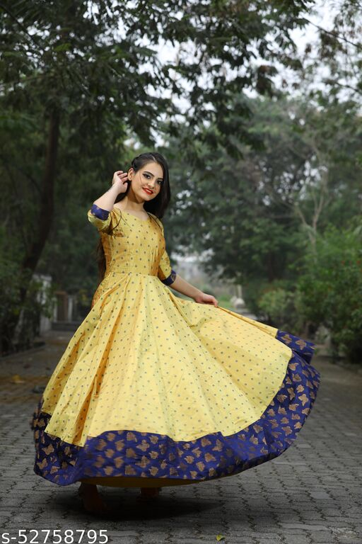 Glowing Light Yellow Colored Partywear Tapetta Gown
