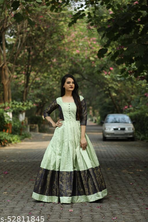 Glowing Designer wear Pista Colored Jacquard bordered Long Gown