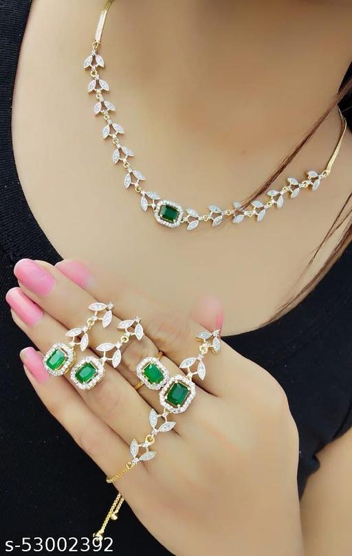 Alloy Designer Gold Plated Combo Jewellery Set (1 Neckalce, 2 Earrings, 1Free Size Bracelet, 1 Free Size Ring)