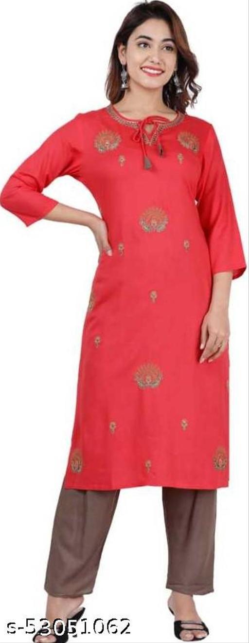 women pink kurta and palazzo