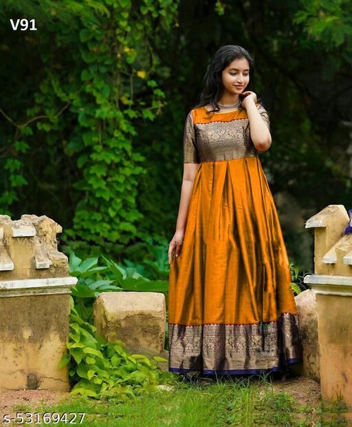 Desirable Mustard Colored Partywear Woven Soft Silk Jacquard Gown