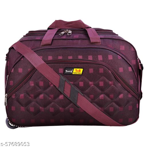 Duffle bag of red colour with chex design