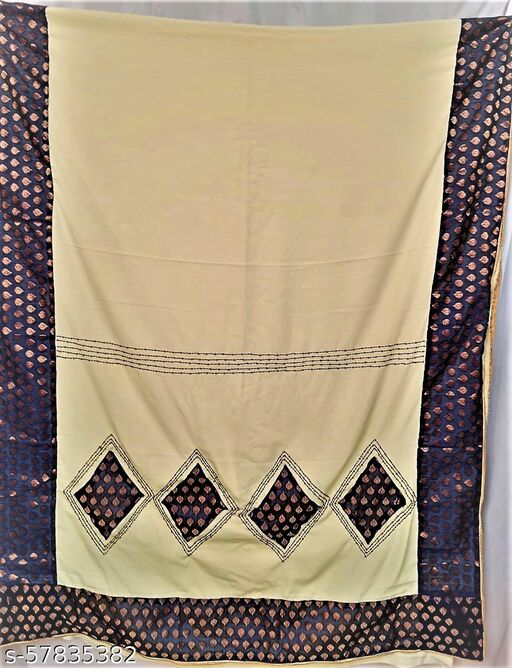 Crape Saree with applique and hand embroidery work