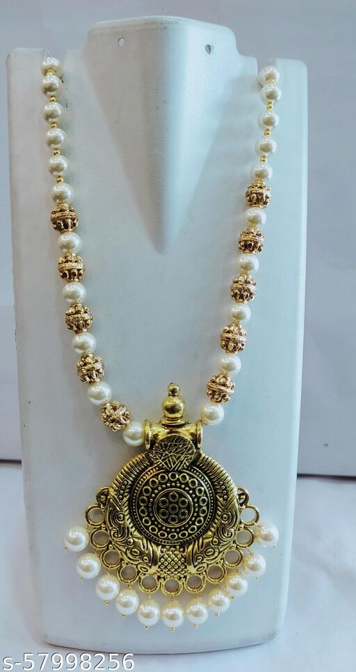 See pearls chain with antique balls and locket