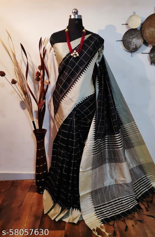 Shangreela Raw silk weaving saree with temple border and checks weaves all over with cream pallu and blouse piece