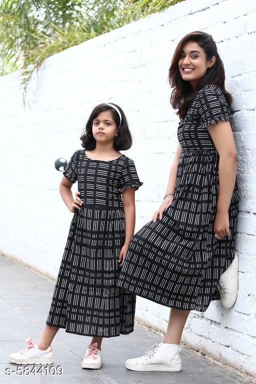 Frocks & Dresses Flawsome Elegant Cotton Mother & Daughter Midi Dresses  *Fabric* Cotton  *Sleeve Length* Three-Quarter Sleeves  *Pattern* Printed  *Multipack* Pack Of 2  *Sizes  *  For Daughter  *4-5 Years (Bust Size* 24 in)  *5-6 Years (Bust Size* 25 in)  *10-11 Years (Bust Size* 28 in)  *11-12 Years (Bust Size* 30 in)  *8-9 Years (Bust Size* 27 in)  *6-7 Years (Bust Size* 25 in)  *7-8 Years (Bust Size* 26 in)  *9-10 Years (Bust Size* 28 in)  *For Mother*   *L (Bust Size* 40 in, Length Size  *Sizes Available* KID - 4-5 Years/ Parent - XL, KID - 5-6 Years/ Parent - XL, KID - 6-7 Years/ Parent - XL, KID - 7-8 Years/ Parent - XL, KID - 8-9 Years/ Parent - XL, KID - 9-10 years/ Parent - XL, KID - 10-11 Years/ Parent - XL, KID - 11-12 years/ Parent - XL, KID - 4-5 Years/ Parent - XXL, KID - 5-6 Years/ Parent - XXL, KID - 6-7 Years/ Parent - XXL, KID - 7-8 Years/ Parent - XXL, KID - 4-5 Years/ Parent - XS, KID - 8-9 Years/ Parent - XXL, KID - 5-6 Years/ Parent - XS, KID - 9-10 years/ Parent - XXL, KID - 6-7 Years/ Parent - XS, KID - 10-11 Years/ Parent - XXL, KID - 7-8 Years/ Parent - XS, KID - 11-12 years/ Parent - XXL, KID - 8-9 Years/ Parent - XS, KID - 9-10 years/ Parent - XS, KID - 10-11 Years/ Parent - XS, KID - 11-12 years/ Parent - XS, KID - 4-5 Years/ Parent - S, KID - 5-6 Years/ Parent - S, KID - 6-7 Years/ Parent - S, KID - 7-8 Years/ Parent - S, KID - 8-9 Years/ Parent - S, KID - 9-10 years/ Parent - S, KID - 10-11 Years/ Parent - S, KID - 11-12 years/ Parent - S, KID - 4-5 Years/ Parent - M, KID - 5-6 Years/ Parent - M, KID - 6-7 Years/ Parent - M, KID - 7-8 Years/ Parent - M, KID - 8-9 Years/ Parent - M, KID - 9-10 years/ Parent - M, KID - 10-11 Years/ Parent - M, KID - 11-12 years/ Parent - M, KID - 4-5 Years/ Parent - L, KID - 5-6 Years/ Parent - L, KID - 6-7 Years/ Parent - L, KID - 7-8 Years/ Parent - L, KID - 8-9 Years/ Parent - L, KID - 9-10 years/ Parent - L, KID - 10-11 Years/ Parent - L, KID - 11-12 years/ Parent - L *    Catalog Name: Flawsome El