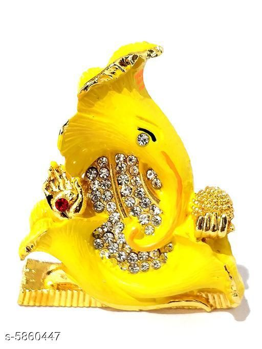 Religious Idols & Paintings Elite Traditional Ganesh Ji Idols  *Material* Metal  *Pack* Pack of 1  *Product Length* 6 cm  *Product Breadth* 2 cm  *Product Height* 7 cm  *Sizes Available* Free Size   Supplier Rating: ★3.9 (2427) SKU: yellow Shipping charges: Rs1 (Non-refundable) Pkt. Weight Range: 113  Catalog Name: Elite Traditional Ganesh Ji Idols - ATC KURTIS Code: 863-5860447--854