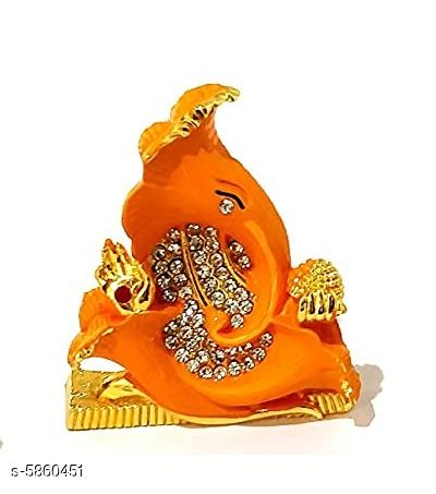 Religious Idols & Paintings Elite Traditional Ganesh Ji Idols  *Material* Metal  *Pack* Pack of 1  *Product Length* 6 cm  *Product Breadth* 2 cm  *Product Height* 7 cm  *Sizes Available* Free Size   Supplier Rating: ★3.9 (2427) SKU: orange Shipping charges: Rs1 (Non-refundable) Pkt. Weight Range: 113  Catalog Name: Elite Traditional Ganesh Ji Idols - ATC KURTIS Code: 863-5860451--854