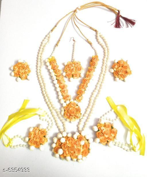 Jewellery Set Sana Designer Women's Jewellery Set  *Base Metal* Foam and paper  *Plating* Gold Plated  *Stone Type* Artificial Flower and pearl work  *Sizing* Adjustable  *Type* Necklace Earrings Bracelet & Maang Tikka  *Multipack* 1  *Description* It Has 1 Pieces Of Necklace , 1 Piece Of Maang Tikka , 1 Pair Of Finger Ring Bracelet & 1 Pair Of Earring  *Sizes Available* Free Size *    Catalog Name: Feminine Chunky Jewellery Sets CatalogID_1010389 C77-SC1093 Code: 005-6354933-
