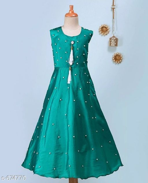 Ethnic Gowns Trendy Girl's Ethnic Gown  *Fabric* Tapeta  *Sleeves* Sleeves Are Not Included  *Size* Age Group (3 - 4 Years) - 24 in Age Group (5 - 6 Years) - 28 in Age Group (7 - 8 Years) - 32 in Age Group (9 - 10 Years) - 36 in Age Group (11 - 12 Years) - 40 in  *Type* Stitched  *Description* It Has 1 Piece Of Girl's Ethnic Gown  *Work* Pearl Work With Bow On Back Side  *Sizes Available* 3-4 Years, 5-6 Years, 7-8 Years, 9-10 Years, 11-12 Years *   Catalog Rating: ★4.1 (708)  Catalog Name: Little Princess Adorable Ethnic Gown Vol 4 CatalogID_76535 C61-SC1400 Code: 883-674770-