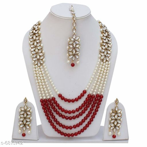 Jewellery Set Bridal Jewellery Set Of Crystal Moti & Kundan Necklace & Earrings  *Base Metal* Alloy  *Plating* Gold Plated  *Stone Type* Artificial Beads  *Sizing* Non-Adjustable  *Multipack* 1 Bridal Jewellery Set Of Crystal Moti & Kundan Necklace & Earrings For Women  *Sizes Available* Free Size *   Catalog Rating: ★3.8 (14)  Catalog Name: Elite Fusion Jewellery Sets CatalogID_1087804 Code: 514-6815742-