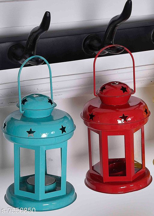 Others Red And Blue lantern como Material: Metal Pack: Pack of 2 Product Length: 10 cm Product Breadth: 10 cm Product Height: 14 cm Country of Origin: India Sizes Available: Free Size   Catalog Rating: ★4.4 (198)  Catalog Name: Stylo Candle Candle Holders CatalogID_1219626 C81-SC1274 Code: 692-7550850-